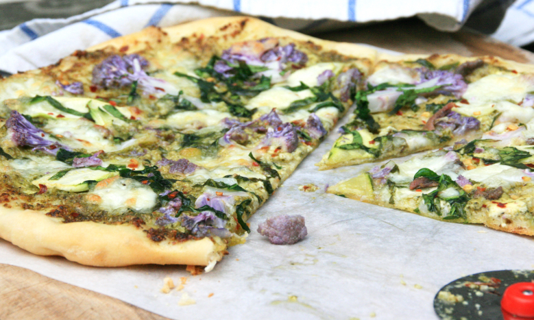 Green pizza with purple cauliflower and chilli