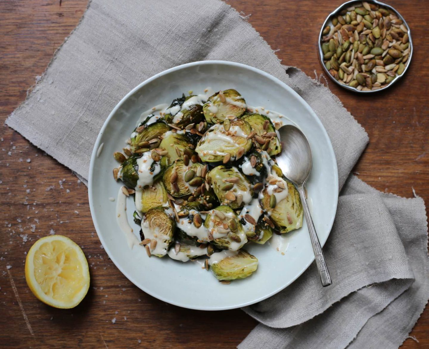 Roasted Brussels sprouts with tahini and toasted seeds