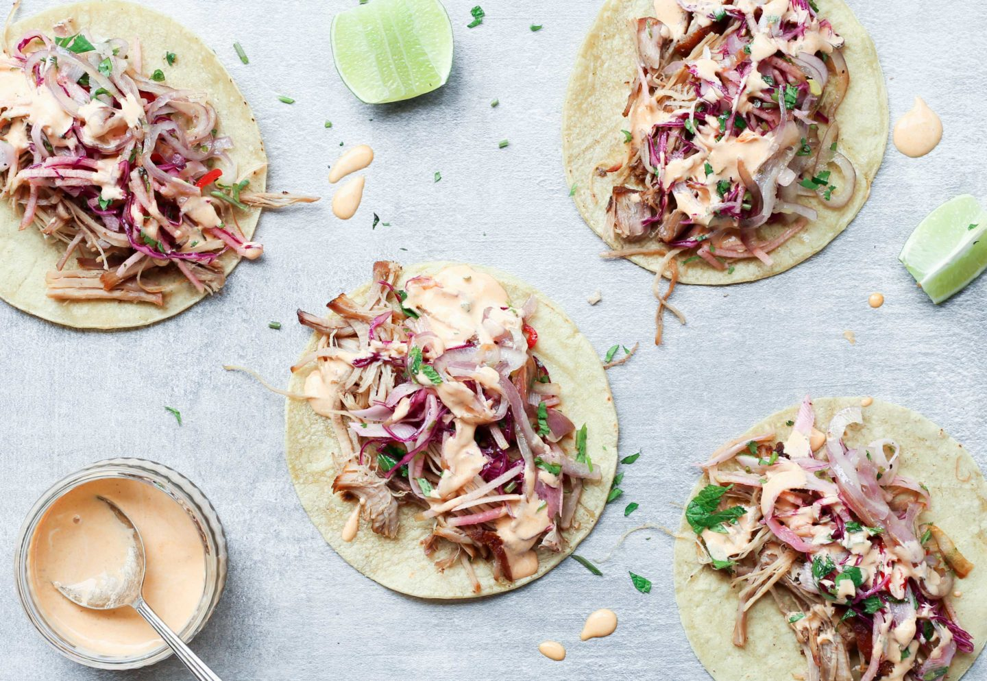 Pork shoulder tacos with apple and fennel slaw and chipotle